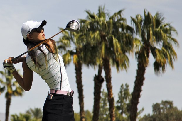 Michelle Wie watches her tee shot on the 11th hole during the pro-am round of the LPGA Kraft Nabisco Championship golf tournament in Rancho Mirage, Calif., Wednesday, March 28, 2012.