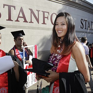 Golfer Michelle Wie smiles as she graduates from Stanford University during ceremonies in Stanford, Calif., Sunday, June 17, 2012.