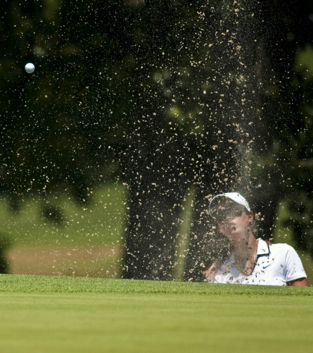Michelle Wie chips from a sand trap on the ninth green during the second round of the LPGA NW Arkansas Championship golf tournament in Rogers, Ark., Saturday, June 30, 2012.