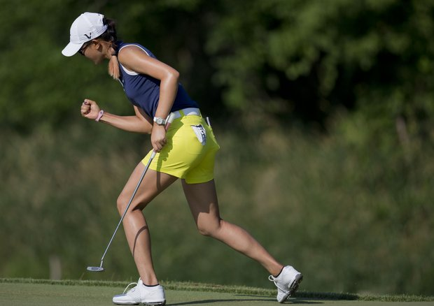 Michelle Wie reacts after putting for birdie on 16 during the third round of the U.S. Women's Open golf tournament on Saturday, July 7, 2012, in Kohler, Wis.