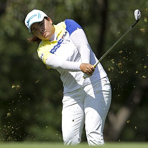 South Korea's Inbee Park watches her shot after she tees off on the 3th hole during the fourth day of the LPGA Lorena Ochoa Invitational at the Guadalajara Country Club in Guadalajara, Mexico, Sunday, Nov. 11, 2012.