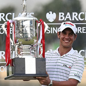 Matteo Manassero of Italy poses with his trophy after winning the Singapore Open golf tournament in the third playoff match against Louis Oosthuizen of South Africa, at the Serapong Course at Sentosa Golf Club in Singapore on Sunday Nov. 11, 2012.