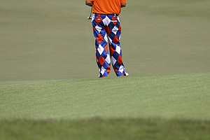 John Daly of the U.S. stands on the eighteenth hole during the first round of the Singapore Open golf tournament at the Serapong Course at Sentosa Golf Club in Singapore on Friday Nov. 9, 2012.