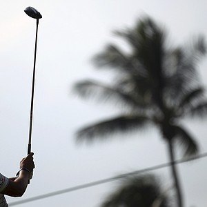 Matteo Manassero of Italy is silhouetted as he tees of on the thirteenth hole during the third round of the Singapore Open golf tournament at the Serapong Course at Sentosa Golf Club in Singapore on Sunday, Nov. 11, 2012.