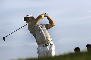 Rory McIlroy of Northern Ireland tees off on the ninth hole during the third round of the Singapore Open golf tournament at the Serapong Course at Sentosa Golf Club in Singapore on Sunday, Nov. 11, 2012.