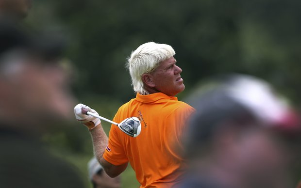 John Daly of the U.S. watches the ball after hitting it off the eleventh hole during the second round of the Singapore Open golf tournament at the Serapong Course at Sentosa Golf Club in Singapore on Friday Nov. 9, 2012.