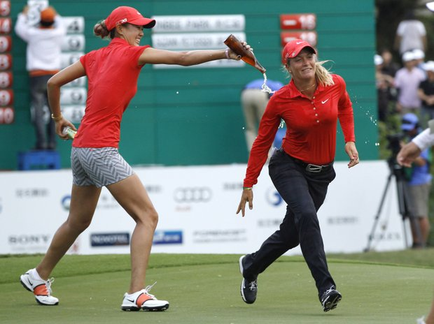 Suzann Pettersen from Norway, right, is poured with beer by Michelle Wie of the United States on the 18th green after winning the Taiwan Championship at the Sunrise Golf & Country Club, Sunday, Oct. 28, 2012 in Yang Mei, Taiwan. Pettersen closed with a 3-under 69 to finish at 19 under and earned US$300,000 for her 10th LPGA Tour title.