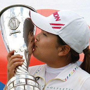Park In-bee of South Korea kisses her trophy in front of the national flag, after winning the Evian Masters women's golf tournament in Evian, eastern France, Sunday, July 29, 2012.