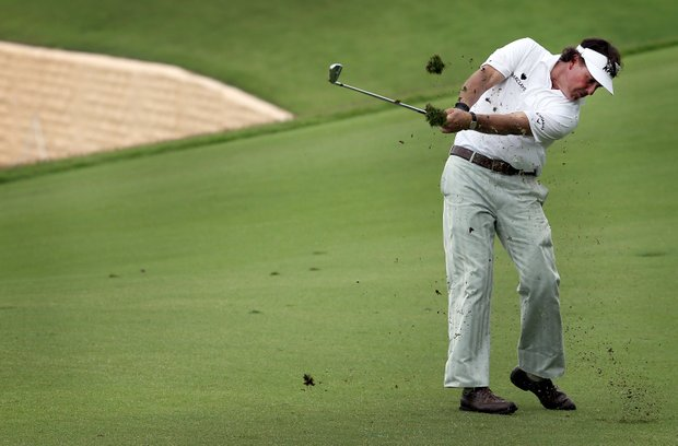 Phil Mickelson of the U.S. hits a shot on the ninth hole during the second round of the Singapore Open golf tournament at the Sentosa Golf Club in Singapore on Saturday Nov. 10, 2012.