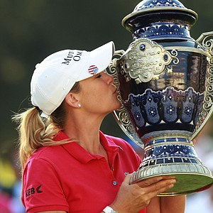 Cristie Kerr kisses the trophy after winning the LPGA Lorena Ochoa Invitational.