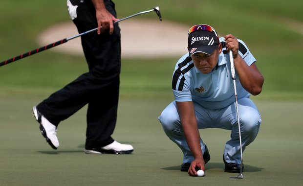 Chapchai Nirat of Thailand lines up a putt on the ninth green during the second round of the Singapore Open golf tournament at the Sentosa Golf Club in Singapore on Saturday Nov. 10, 2012.