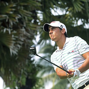 Mateo Manassero of Italy tees off on the fifteenth hole during the third round of the Singapore Open golf tournament at the Serapong Course at Sentosa Golf Club in Singapore on Sunday, Nov. 11, 2012.