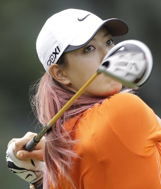 Michelle Wie watches her tee shot on the 11th hole during the first round of the Kingsmill Championship LPGA Tour golf tournament in Williamsburg , Va., Thursday, Sept. 6, 2012.