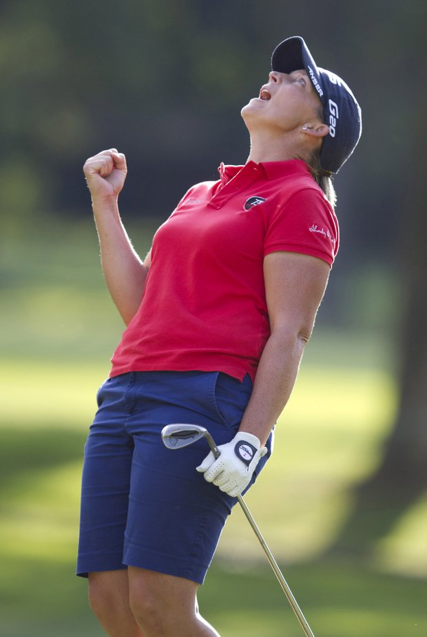 Angela Stanford of the U.S. shows her disappointment during the third day of the LPGA Lorena Ochoa Invitational at the Guadalajara Country Club in Guadalajara, Mexico, Saturday, Nov. 10, 2012.