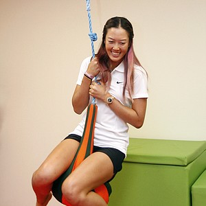 Golfer Michelle Wie of the United States plays flying fox as she visits to Creative Arts Centre for autistic children during its launch in Shah Alam, outside Kuala Lumpur, Malaysia, Monday, Oct. 8, 2012.