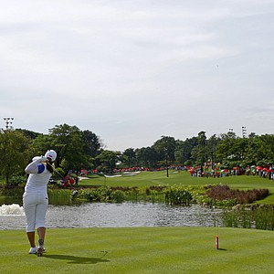Inbee Park of South Korea tees off on the 3rd hole during the final round of the LPGA Malaysia golf tournament at Kuala Lumpur Golf and Country Club in Kuala Lumpur, Malaysia, Sunday, Oct. 14, 2012.