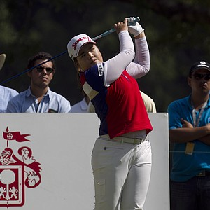 South Korea's Inbee Park watches her shot after she tees off on hole 2 during the third day of the LPGA Lorena Ochoa Invitational at the Guadalajara Country Club in Guadalajara, Mexico, Saturday, Nov. 10, 2012.