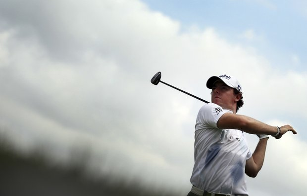 Rory McIlroy of Northern Ireland tees off on the eleventh hole during the second round of the Singapore Open golf tournament at the Serapong Course at Sentosa Golf Club in Singapore on Friday Nov. 9, 2012.
