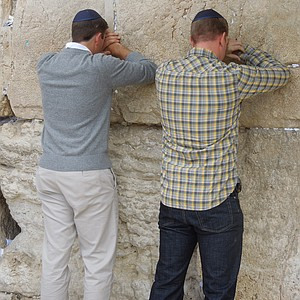 Michael Thompson, left, and Hunter Mahan pray at the Western Wall.
