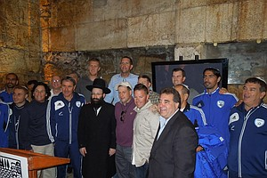 The golfers and retired NBA players on the goodwill tour meet the Israeli national soccer team. Arn Tellem (in purple, bottom row) and Rabbi Shmuel Rabinovitch (also at center).