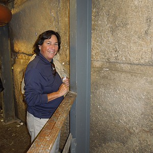 Amy Alcott prepares to nestle her note into a crevice of the Western Wall.