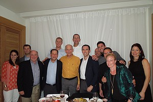 Former Israeli Prime Minister Ehud Olmert (center, in mustard-color shirt), is an avid sportsman and joined the group for dinner in Tel Aviv.