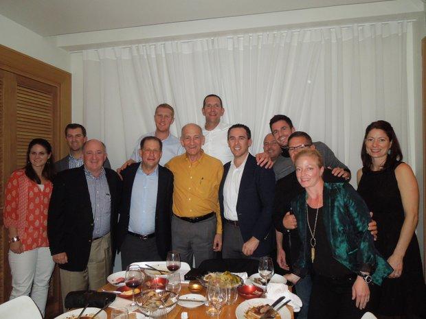 Former Israeli Prime Minister Ehud Olmert (center, in mustard-color shirt), is an avid sportsman and joined the group for dinner in Tel Aviv.