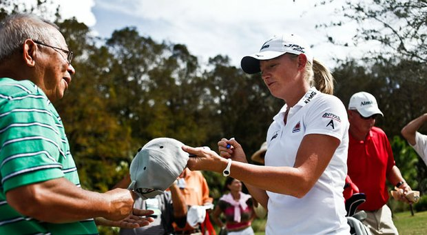Stacy Lewis signs an autograph for a fan early week at the CME Group Titleholders.