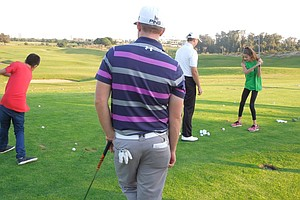 Hunter Mahan and Michael Thompson teach kids from Peace Players the basics of golf.