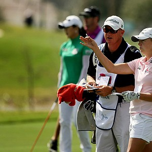 Stacy Lewis with her caddie during the final round of the CME Group Titleholders at Twin Eagles Club.