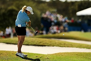 Kristy McPherson hits her second shot at No. 18 during the final round of the CME Group Titleholders at Twin Eagles Club.