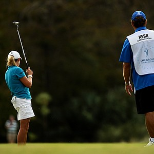 Cristie Kerr's caddie Worth Blackwelder lifts his leg encouraging the ball to drop at  No. 17 during the final round of the CME Group Titleholders at Twin Eagles Club.