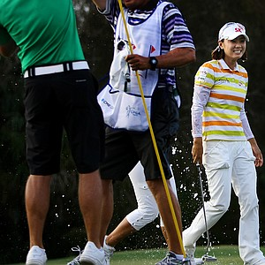 Na Yeon Choi and her caddie Jason Hamilton are sprayed with champagne after the final round of the CME Group Titleholders at Twin Eagles Club.