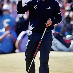 Adam Scott celebrates his win on the 18th hole during Day 4 of the Australia Masters.