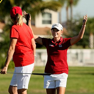Stacy Lewis puts her arms up as Betsy King's putt drops during the ISPS Handa Heroes, a nine-hole, made-for-TV charity event honoring golf philanthropist Dr. Haruhisa Handa, Monday, Nov. 19 at TwinEagles Golf Club in Naples, Fla.