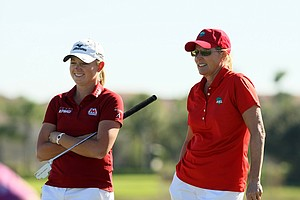 Stacy Lewis, left, and her partner, Betsy King, right during the ISPS Handa Heroes, a nine-hole, made-for-TV charity event honoring golf philanthropist Dr. Haruhisa Handa, Monday, Nov. 19 at TwinEagles Golf Club in Naples, Fla.