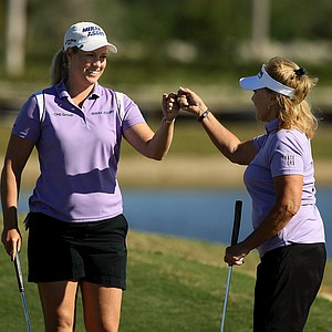 Partners Brittany Lincicome and Jan Stephenson celebrate during the ISPS Handa Heroes, a nine-hole, made-for-TV charity event honoring golf philanthropist Dr. Haruhisa Handa, Monday, Nov. 19 at TwinEagles Golf Club in Naples, Fla.