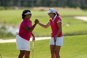 Nancy Lopez and Paula Creamer having fun during the ISPS Handa Heroes, a nine-hole, made-for-TV charity event honoring golf philanthropist Dr. Haruhisa Handa, Monday, Nov. 19 at TwinEagles Golf Club in Naples, Fla.