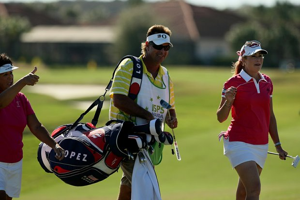 Paula Creamer with partner Nancy Lopez and Lopez's caddie during the ISPS Handa Heroes, a nine-hole, made-for-TV charity event.