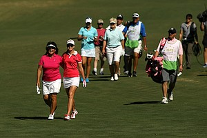 Partners Nancy Lopez and Paula Creamer walk down the 18th fairway during the ISPS Handa Heroes, a nine-hole, made-for-TV charity event.
