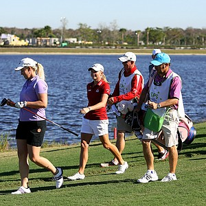 Stacy Lewis and Brittany Lincicome with their caddies walk off the tee during the ISPS Handa Heroes, a nine-hole, made-for-TV charity event at TwinEagles Golf Club in Naples, Fla.--(Photo by Tracy Wilcox/GOLFWEEK)