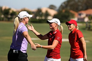 Stacy Lewis gives Brittany Lincicome a concilatory hug after they came out ahead during the ISPS Handa Heroes, a nine-hole, made-for-TV charity event.
