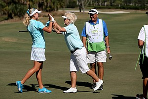 Pat Bradley high fives her partner Lexi Thompson after Thompson made her birdie at No. 18 during the ISPS Handa Heroes, a nine-hole, made-for-TV charity event. Betsy King and Stacy Lewis won the event.