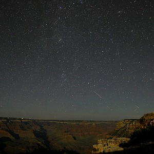 A 3-minute exposure of the stars over the Grand Canyon National Park in Arizona behind the El Tovar hotel.