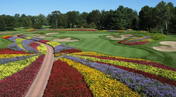 "The par-3 16th hole at SentryWorld is the ""flower hole."""