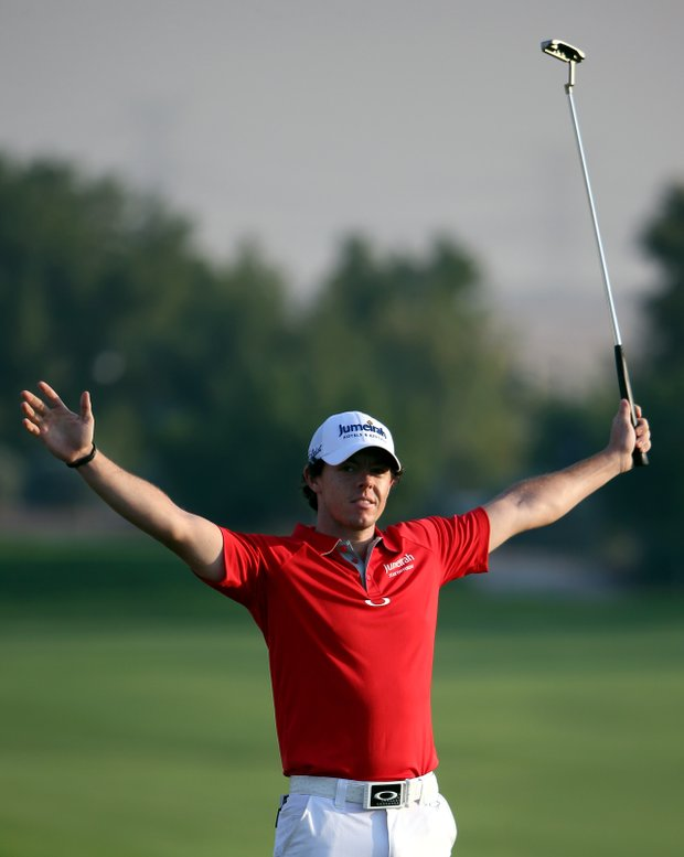 Rory McIlroy celebrates after winning the DP World Tour Championship on the 18th green.