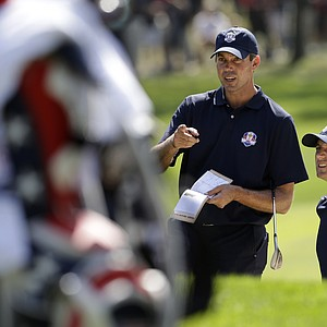 USA's Matt Kuchar and Dustin Johnson look over the seventh hole at the Ryder Cup PGA golf tournament Tuesday, Sept. 25, 2012, at the Medinah Country Club in Medinah, Ill.