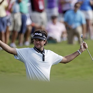 Bubba Watson gestures after chipping in for birdie on the 17th hole during the second round of the Tour Championship golf tournament, in Atlanta on Friday, Sept. 21, 2012.
