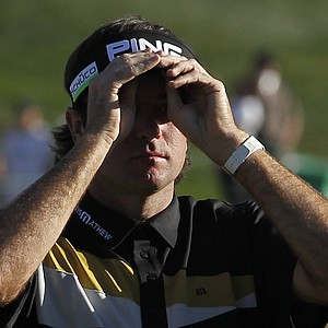 Bubba Watson adjusts his visor as he walks off the 18th green during the final round of the Phoenix Open golf tournament Sunday, Feb. 5, 2012, in Scottsdale, Ariz.