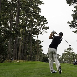 Dustin Johnson hits from the 18th tee of the Spyglass Hill Golf Course during the second round of the AT&T Pebble Beach National Pro-Am PGA Tour golf tournament in Pebble Beach, Calif., Friday, Feb. 10, 2012.